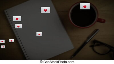 Multiple envelope with heart icon floating against book, coffee cup and glasses on wooden surface