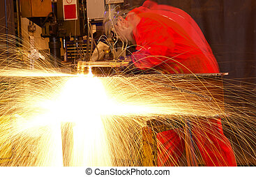 Multiple exposure of welder cutting metal with sparks -...