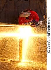 Multiple exposure of welder making sparks - Multiple...