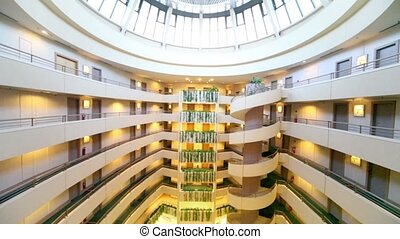 Multiple floor hotel interior with cafe on first floor