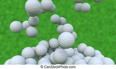 Multiple golf balls falling down against green grass...