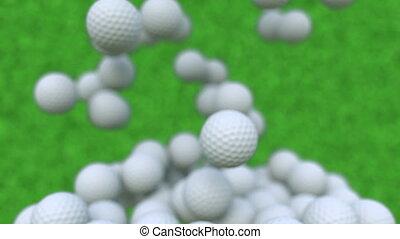 Multiple golf balls falling down, shallow focus - Multiple...