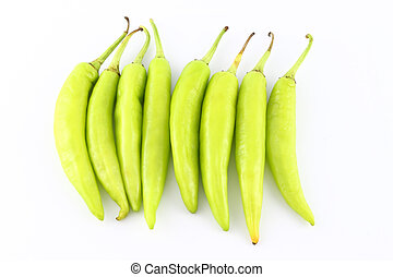 Multiple green chili peppers on white background.