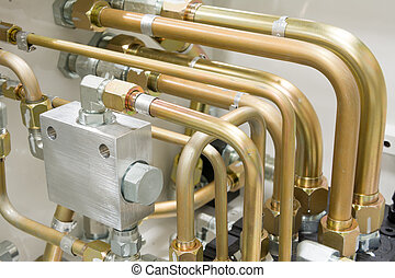 Multiple Hydraulic Tubes and Fittings on Hydraulic Equipment