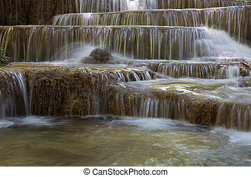 Multiple layer waterfalls in deep natural forest