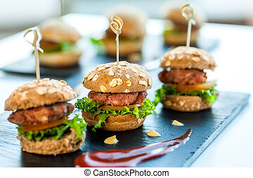 Multiple min beef hamburgers. - Close up of mini hamburgers...