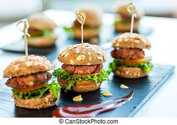 Multiple min beef hamburgers. - Close up of mini hamburgers...