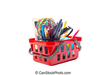 Multiple office tools in a shopping cart, isolated on white background