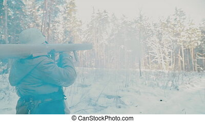 Multiple shots slow motion Re-enactor Dressed As World War II German Wehrmacht Infantry Soldiers Shooting from Anti-tank Cannon and Open Fire From mortar in Winter Snowy Forest