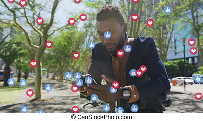 Multiple social media icons against african american man with bicycle using smartphone