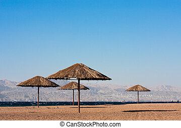 Multiple sunshades on a beach