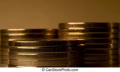 Multiple towers of gold coins. Financial concept.