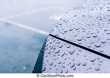 Multiple water drops on car new metallic paint