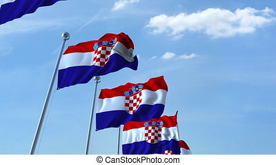Multiple waving flags of Croatia against the blue sky