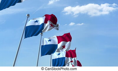Multiple waving flags of Panama against the blue sky -...