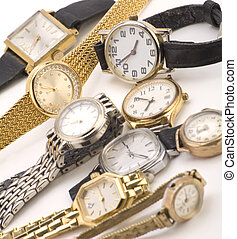 Multiple Wrist watches isolated on a white background.