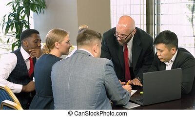 Multiracial business people meeting for briefing in a modern office