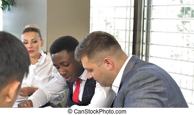 Multiracial business team discussing together business plans in slow motion