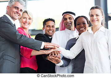 multiracial business team hands together - close up of...