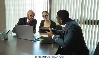 Multiracial businessmen discuss new ideas and plans of the...
