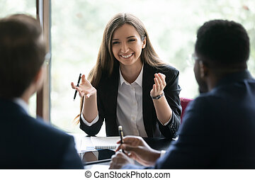 Multiracial businesspeople discuss company business project together