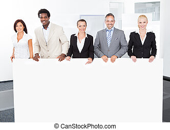 Multiracial Businesspeople Holding Placard