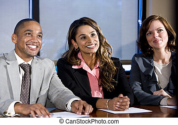Multiracial businesspeople watching presentation -...