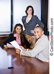 Multiracial businesspeople working on report