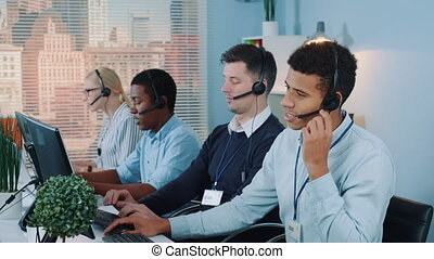 Multiracial call center agent feeling exhausted and broken-...