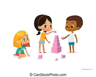 Multiracial children build tower with pink blocks. Kids play...