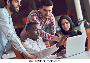 Multiracial contemporary business people working connected...