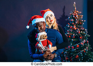 multiracial Couple in love having fun and spending Christmas together
