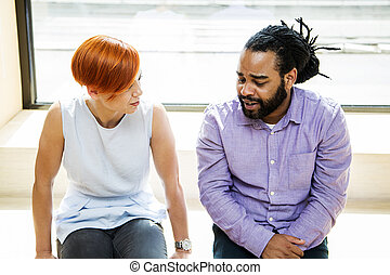 Multiracial couple talking