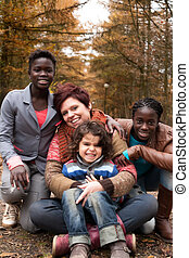 Multiracial family in the autumn - Happy family with foster...