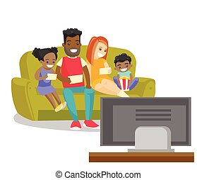 Multiracial family watching television at home.