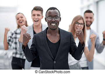 multiracial group of businessmen rejoices in victory