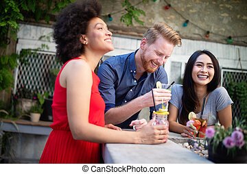 Multiracial group of friends having fun and talking
