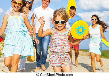 Multiracial group of friends walking at the beach