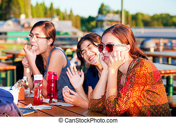 Multiracial group of young women enjoying time together by lake