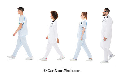 Multiracial Medical Team Walking In Row