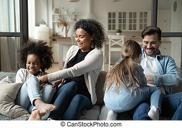 Multiracial parents tickling little daughters family having ...