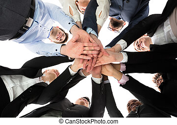 Multiracial People Stacking Hands - Low Angle View Of...