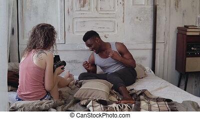 Multiracial photoshoot. Photographer woman taking photo of...