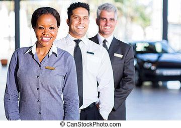 multiracial vehicle sales team