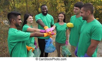 Multiracial volunteers rejoicing at work done