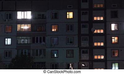 Multistorey Building with Changing Window Lighting At Night. Time lapse.