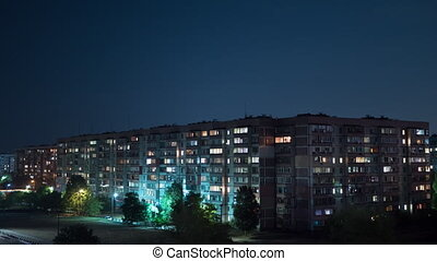 Multistorey Building with Changing Window Lighting At Night. Timelapse