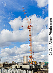 Multistorey houses and large crane