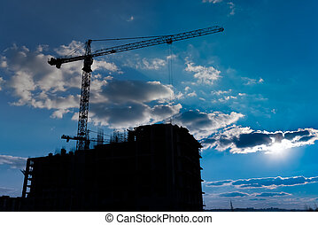 Multistorey housing under construction and industrial construction cranes