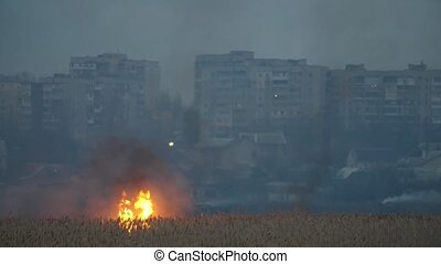Multistoried buildings on the Dnipro bank and forks of flame...